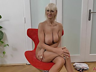 Supreme looking, platinum-blonde mature with gigantic jugs, Roxana took off her sundress and did some bare posing