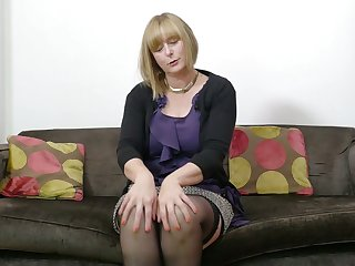 Mature auburn lady April is really into working on her wet pussy