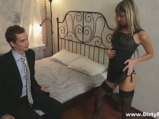 Petite blond student Gina Gerson serves her group mates for money