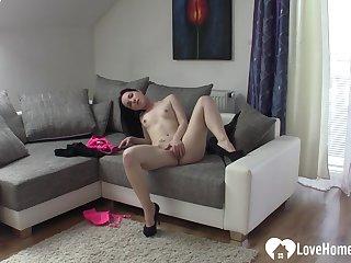 Dark Hair babe in high heels pleasures herself