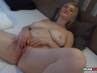 Beautiful blond with big honkers shows off