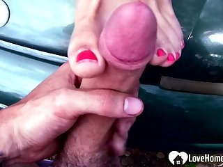 Incredible milf gives a footjob outdoors before making love